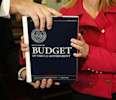 House Budget Committee member Marsha Blackburn (R-TN) is handed a copy of U.S. President Barack Obama&#39;s FY2014 budget proposal upon its arrival on Capitol Hill in Washington April 10, 2013.