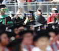Ohio State University graduates arrive to participate in the commencement ceremony in Columbus