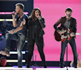"Hillary Scott, Charles Kelley and Dave Haywood of Lady Antebellum perform the song ""Downtown"" during the 48th ACM Awards in Las Vegas"
