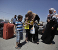 Palestinian girl hugs her relative who arrived from Egypt, at the Rafah border crossing in the southern Gaza Strip