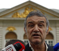 Romanian lawmaker and soccer club owner George Becali talks to the media in Bucharest