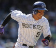 Colorado Rockies' Carlos Gonzalez runs to first after hitting an unsuccessful bunt during the eighth inning of a baseball game against the Arizona Diamondbacks, Wednesday, May 22, 2013, in Denver ...