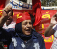 A woman chants slogans during a demonstration to mark Labour Day, or May Day, organized by Lebanese leftist activists in Beirut