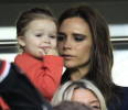 Paris Saint Germain's midfielder David Beckham 's wife Victoria Beckham and her daughter Harper, arrive to attend the French League One soccer match between PSG and Brest, at the Parc des Princes ...