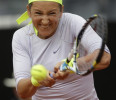 Belarus &#39; Victoria Azarenka returns the ball to Italy&#39;s Sara Errani during their semi final match at the Italian Open tennis tournament in Rome, Saturday, May 18, 2013. Azarenka won 6-0, 7-5