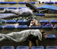 Earthquake victims sleep at a stadium after their homes were destroyed by Saturday&#39;s quake in Baoxing county of southwest China&#39;s Sichuan province Tuesday, April 23, 2013. The efforts under way in ...