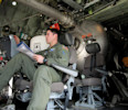 Tech. Sgt. Steve Morris works on a North Carolina Air National Guard C - 130 cargo plane fitted with the Modular Airborne Fire Fighting System, a device for deploying fire retardant against wildfires ...