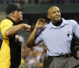 Home plate umpire C.B. Bucknor, right, ejects Pittsburgh Pirates manager Clint Hurdle who argues against him for calling Houston Astros&#39; Jason Castro safe on a play at the plate in the eleventh ...