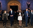 Britain's Kate the Duchess of Cambridge, center, with her husband Prince William , second left, and his brother Prince Harry, second right, walk through the set used to depict Hogwart's 'Great Hall ...