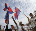 Mu, Cambodia 's lawmaker from the opposition Sam Rainsy Party, waves the national flag during a protest to demand free and fair elections in Phnom Penh