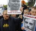 United Russia deputy Milonov and gay rights opponents hold portraits of convicted paedophiles during a rally to mark International Day Against Homophobia and Transphobia in St. Petersburg