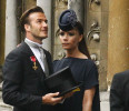 File photo of soccer star David Beckham and his wife Victoria arriving at Westminster Abbey in London