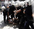 Riot police surround a protester during a protest against Turkey's PM Erdogan and his government's policy on Syria, in Ankara
