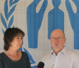 British Foreign Office Minister Alistair Burt speaks at a news conference as UNHCR's Representative in Lebanon, Ninette Kelley, listens to him during his visit to the offices of UNHCR in Beirut