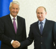 Russia 's President Vladimir Putin shakes hands with Thorbjoern Jagland, secretary general of the Council of Europe, for a meeting, at the Bocharov Ruchei residence in the Black Sea resort of Sochi