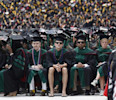 A student in flip flops and shorts attends commencement at Ohio State University