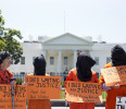 Activists wearing orange jumpsuits mark the 100th day of prisoners&#39; hunger strike at Guantanamo Bay during a protest in front of the White House in Washington