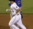 Pittsburgh Pirates ' Travis Snider (23) trots past Chicago Cubs third baseman Cody Ransom as he rounds the bases after hitting a grand slam off Chicago Cubs relief pitcher Shawn Camp during the sixth ...