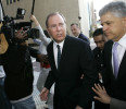 FILE - In this Oct. 23, 2006, file photo former Enron CEO Jeff Skilling, left, leaves the federal courthouse with his attorney Daniel Petrocelli, right, after being sentenced to 292 months in ...