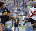 River Plate&#39;s Carlos Sanchez, right, fights for the ball against Boca Junior&#39;s Walter Erviti, left, during an Argentina&#39;s league soccer match in Buenos Aires, Argentina, Sunday, May 5, 2013
