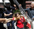 Riot police detain a protester during a protest against Turkey's Prime Minister Tayyip Erdogan and his government's policy on Syria, in Ankara