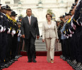 Speaker of the House John Boehner and House Minority Leader Nancy Pelosi walk through an honor cordon at the National Peace Officers Memorial Service at the Capitol in Washington