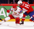Belarus &#39; Meleshko fights for the puck with Norway&#39;s Skroder during their 2013 IIHF Ice Hockey World Championship preliminary round match at the Globe Arena in Stockholm