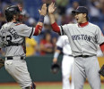 Boston Red Sox relief pitcher Junichi Tazawa, right, of Japan , celebrates with catcher Jarrod Saltalamacchia after closing out the Tampa Bay Rays during the ninth inning of a baseball game Thursday ...