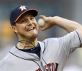 Houston Astros starting pitcher Erik Bedard throws against the Pittsburgh Pirates in the first inning of the baseball game on Saturday, May 18, 2013, in Pittsburgh