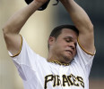Pittsburgh Pirates starting pitcher Wandy Rodriguez (51) wipes his head during the first inning of a baseball game against the Chicago Cubs in Pittsburgh Tuesday, May 21, 2013
