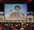 Lebanon's Hezbollah leader Nasrallah is projected on a screen during a live broadcast at an event marking the 25th anniversary of the establishment of Al-Nour radio station in Beirut