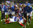 Glasgow Rangers team celebrates with the Scottish 3rd Division trophy following their soccer match against Berwick Rangers in Glasgow