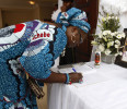 A woman signs the condolence register at the funeral of Nigerian author Chinua Achebe in his hometown of Ogidi