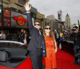 "Cast member Robert Downey Jr . waves next to his wife Susan as they arrive at the premiere of ""Iron Man 3"" at El Capitan theatre in Hollywood"