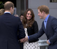 Britain's Kate the Duchess of Cambridge stands with her husband Prince William , left, and his brother Prince Harry, right, as they are greeted upon their arrival to attend the inauguration of ...