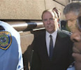 Former Enron Corp chief executive Skilling walks with attorney Petrocelli after he was sentenced to more than 24 years in Federal court in Houston