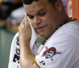Pittsburgh Pirates starting pitcher Wandy Rodriguez wipes his face as he sits in the dugout during the second inning of a baseball game against the Chicago Cubs in Pittsburgh Tuesday, May 21, 2013