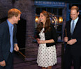 Britain's Kate the Duchess of Cambridge with her husband Prince William , right, and his brother Prince Harry hold their wands on the film set used to depict Diagon Alley in the Harry Potter Films ...