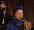 Sirleaf gestures during an onstage newsmakers interview with Reuters in Washington
