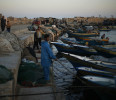 Palestinian fishermen work at the seaport of Gaza City