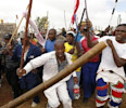 Striking miners chant slogans as they gather at the AngloGold Ashanti mine in Carletonville, northwest of Johannesburg