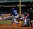 Toronto Blue Jays Kawasaki hits a two RBI single in front of Boston Red Sox catcher Saltalamacchia in the second inning of their MLB American League baseball game in Boston
