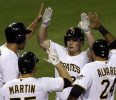 Pittsburgh Pirates ' Travis Snider, second from right, is greeted by teammates who were on base for his grand slam, Garrett Jones, left, Russell Martin, second from left, and Pedro Alvarez (24 ...