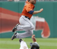 Houston Astros second baseman Jose Altuve, top, hops over Pittsburgh Pirates &#39; Michael McKenry as he is forced out on a fielders choice on a ground ball to third by Clint Barmes in the fifth inning ...