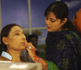 Rana, a transgender independent candidate for the upcoming elections, applies makeup before a local TV programme in Karachi