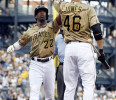 Pittsburgh Pirates &#39; Andrew McCutchen (22) is greeted by on-deck batter Garrett Jones (46) after hitting a home run against the Houston Astros in the first inning of the baseball game Friday, May 17 ...