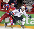 Russia 's Alexander Ovechkin, left, checks Nate Thompson of team USA during the 2013 Ice Hockey IIHF World Championships Group B Quarterfinal match Russia vs USA in Helsinki, Finland on Thursday May ...