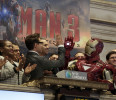 "Actor Robert Downey Jr . gives a high-five to his ""Iron Man"" character during opening bell ceremonies of the New York Stock Exchange, Tuesday, April 30, 2013. Stock prices are opening mostly lower on ..."