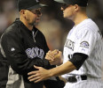 Colorado Rockies manager Walt Weiss congratulates Jordan Pacheco following a baseball game against the San Francisco Giants on Friday, May 17, 2013, in Denver. Colorado defeated San Francisco 10-9