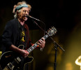 FILE - This April 13, 2013 file photo shows Keith Richards performing at Eric Clapton's Crossroads Guitar Festival 2013 at Madison Square Garden in New York. Keith Richards says he doesn't own an ...
